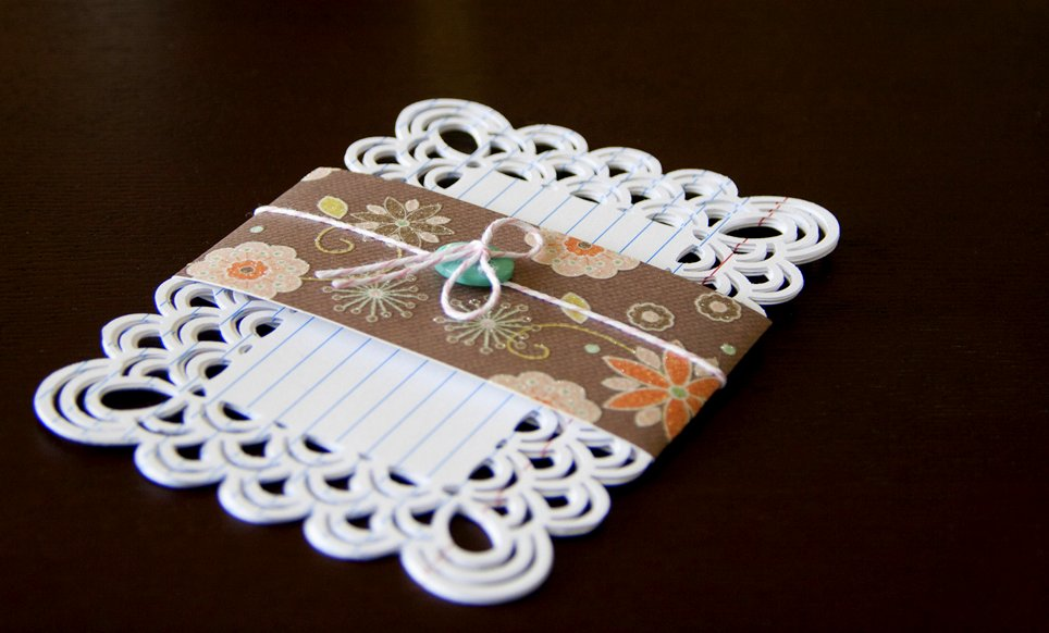 I altered index cards by punching around them with a paper-edger.