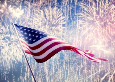 American flag on background of fireworks.