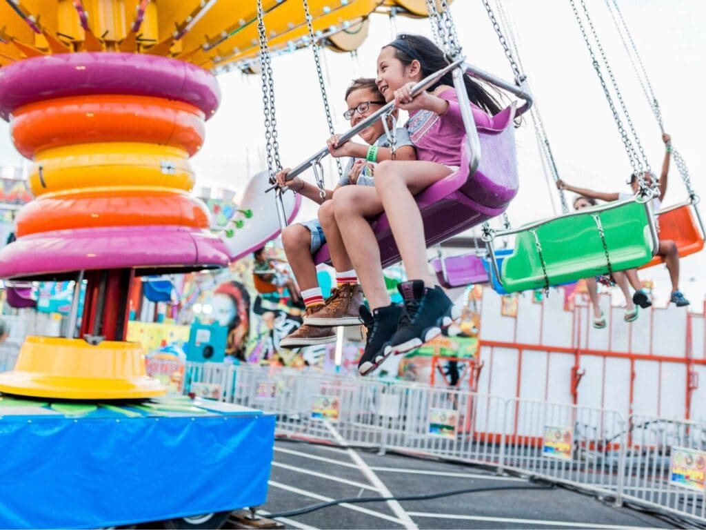 Kids having fun at a carnival on a ride