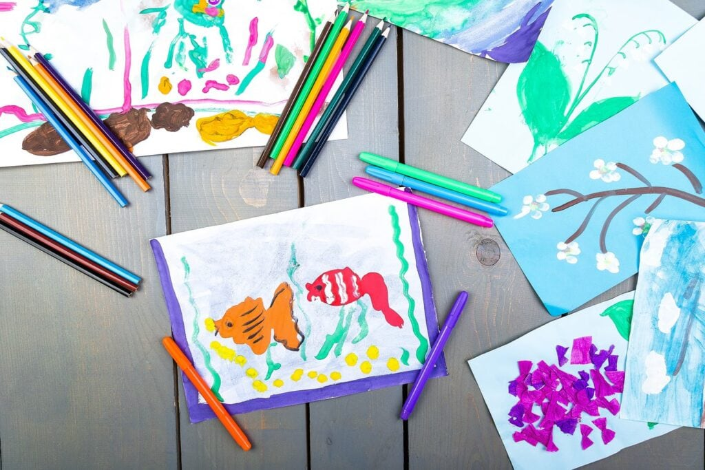Kids painting and artwork of fish