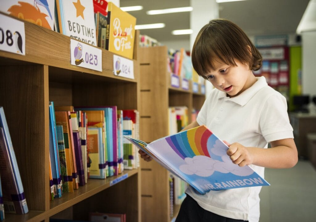 Young boy looking at books in a library